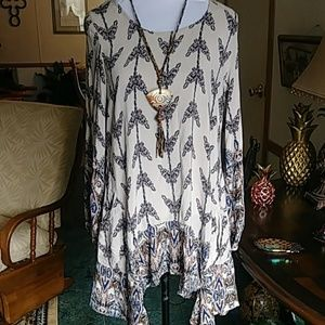 Super cute tunic top with scarf hem.